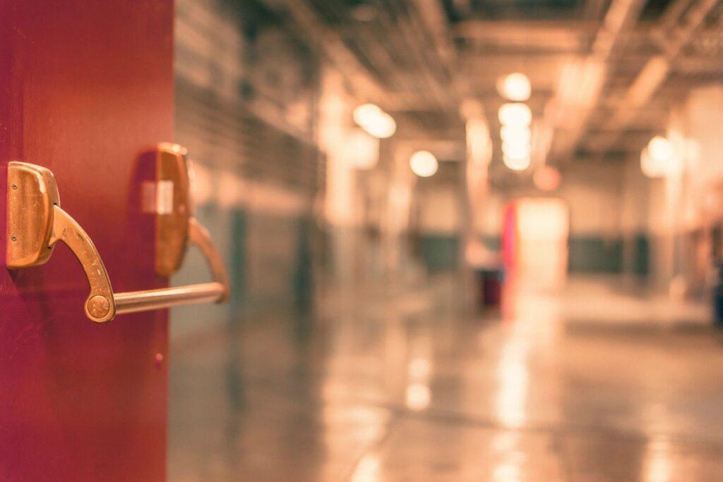 Open door that leads to high school hallway